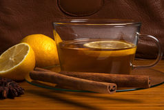 Black tea with lemon and cinnamon Stock Photos