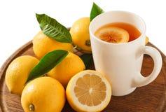 Black tea with lemon closeup. Black tea with lemon on a wooden board, closeup Stock Photography