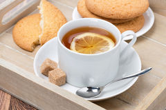 Black tea with lemon and cookies Royalty Free Stock Images