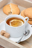 Black tea with lemon and cookies, vertical Royalty Free Stock Photo