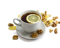 Black tea and lemon in cup Royalty Free Stock Photos