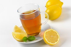 Black tea with lemon. Cup of black tea with lemon - close up Stock Images