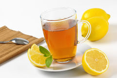 Black tea with lemon. Cup of black tea with lemon - close up Stock Photo