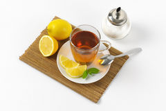 Black tea with lemon. Cup of black tea with lemon and sugar Royalty Free Stock Images