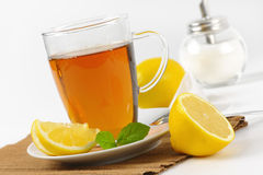 Black tea with lemon. Cup of black tea with lemon and sugar - close up Stock Photo