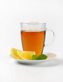 Black tea with lemon. Cup of black tea with lemon on white background Royalty Free Stock Photography