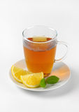 Black tea with lemon. Cup of black tea with lemon on white background Stock Images