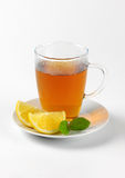 Black tea with lemon. Cup of black tea with lemon on white background Royalty Free Stock Images