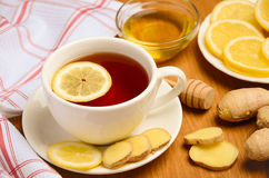 Black tea with lemon, ginger and honey on the wooden table. Stock Photography