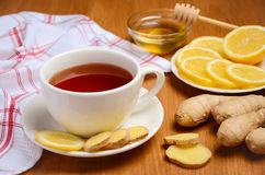 Black tea with lemon, ginger and honey on the wooden table. Horizontal permission. Selective focus Royalty Free Stock Photos