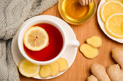 Black tea with lemon, ginger and honey on the wooden table. Royalty Free Stock Photo