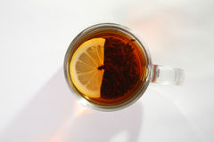 Black tea with lemon. In a glass cup stock photo