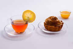 Black tea,lemon, honey and cake. Stock Photography