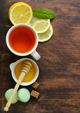 Black tea with lemon and honey Royalty Free Stock Images