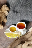 Black tea with lemon and honey Stock Photos