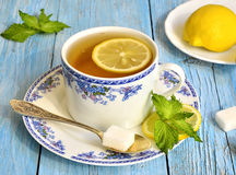 Black tea with lemon and mint. Stock Photography