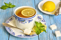 Black tea with lemon and mint. Stock Photos
