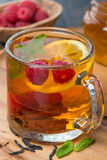 black tea with lemon, mint, raspberry and cinnamon, close-up Royalty Free Stock Photo