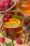 Black tea with lemon, mint, raspberry and cinnamon Royalty Free Stock Images