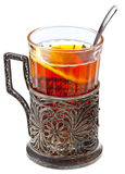 Black tea with lemon in retro glass Royalty Free Stock Images