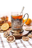 Black tea with lemon in the silver glass-holder Royalty Free Stock Images