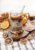 Black tea with lemon in the silver glass-holder Stock Image