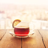 Black tea with lemon slices in a glass cup Royalty Free Stock Photography