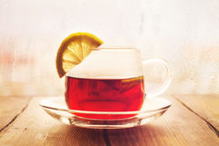 Black tea with lemon slices in a glass cup Stock Photo
