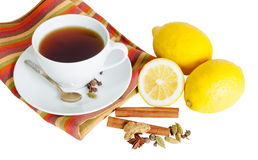 Black tea with lemon and spices isolated on white Stock Photo