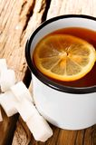 Black tea with lemon and sugar. Royalty Free Stock Photo