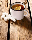 Black tea with lemon and sugar. Stock Photography