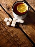 Black tea with lemon and sugar. Stock Image