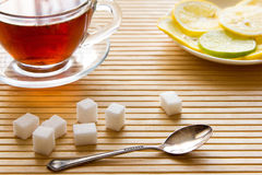 Black tea, lemon and sugar. Black tea, lemon and sugar on the table Royalty Free Stock Photo