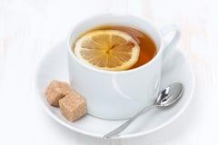 Black tea with lemon on white wooden table Royalty Free Stock Photo