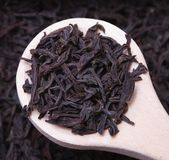 Black tea loose dried. Leaves in spoon Royalty Free Stock Images