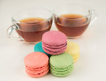 Black tea with macaroons Stock Photography