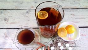 Black tea, manual squeezer with lemons. A jug of black tea and cubes of sugar. Black tea, manual squeezer with lemons. A jug of black tea and cubes of sugar on stock video