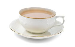 Black tea with milk in a porcelain cup. Stock Image