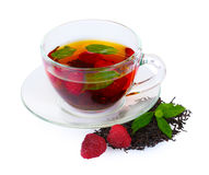 Black tea, mint and raspberry in cup Stock Image