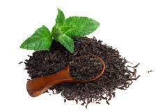 Black tea with mint and a wooden spoon.  Stock Photo