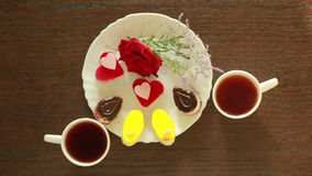 Black tea in mugs. lunch. table with a drink and dessert. view from above. Black tea in mugs. lunch. table with a drink and dessert stock video footage
