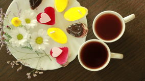 Black tea in mugs. lunch. table with a drink and dessert. view from above. Black tea in mugs. lunch. table with a drink and dessert stock footage