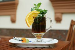 Black tea with orange, mint and dried fruits on a  Stock Photos
