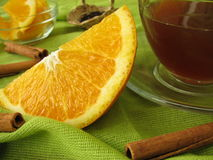 Black tea with oranges and cinnamon Stock Image