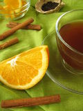 Black tea with oranges and cinnamon Stock Images