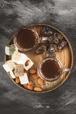 Black tea, oriental sweets, dates and nuts on a dark background. Royalty Free Stock Photography