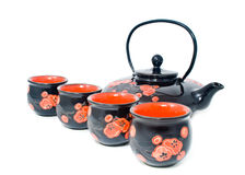 Black tea-pot with glasses Stock Image