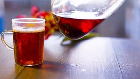 Black tea is poured into a glass.  stock video footage