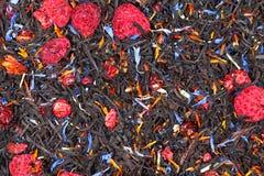 Black tea with raspberry Royalty Free Stock Photography