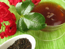 Black tea with rose flowers Stock Photo